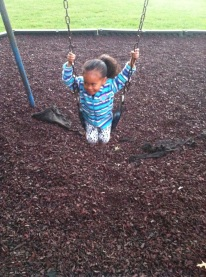 Aspen got brave and swung on the big girl swing