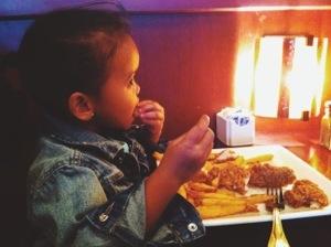 Big girl eating bu herself.