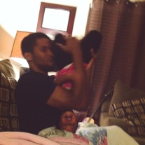 Wrestling with daddy.