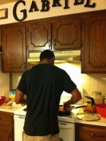 Manning the stove for dinner