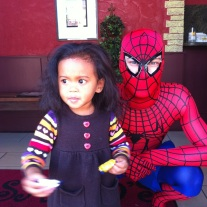 Running away from Spider Man after she got her candy