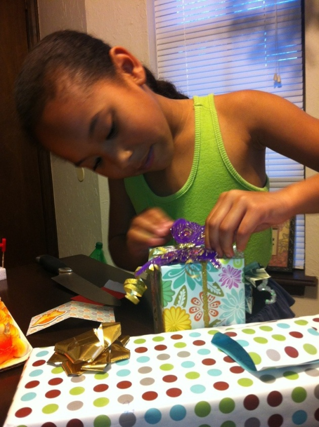 Opening some of her gifts