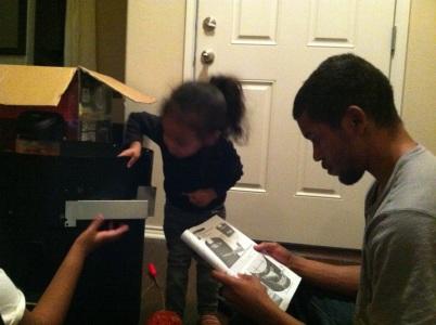Helping dad put together the turkey burner