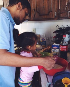 Helping her dad cook